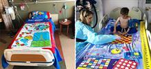 Μπαμπάς μετατρέπει τα σεντόνια του νοσοκομείου σε επιτραπέζια παιχνίδια για να παίζουν τα παιδιά